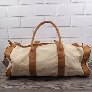 J. Crew canvas with tan trim duffel bag